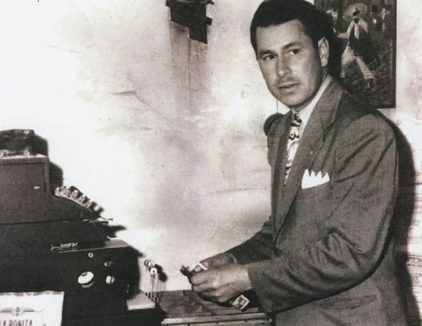 George Salisbury at the cash register in 1927